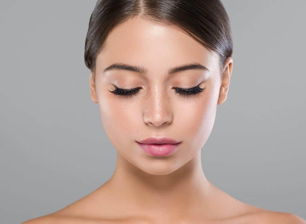 Eyes lashes woman face close up natural make up healthy skin